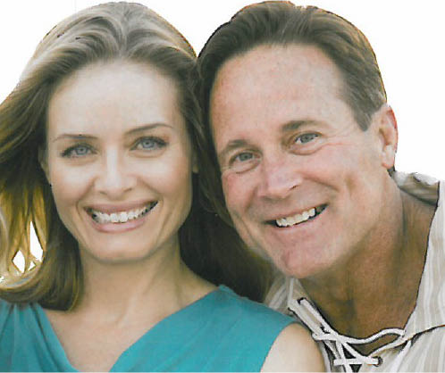 Couple smiling after dental scaling and polishing; dental cleaning; dental exam; dentist office San Juan Capistrano
