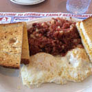 breakfast; fried eggs; corned beef hash; toast