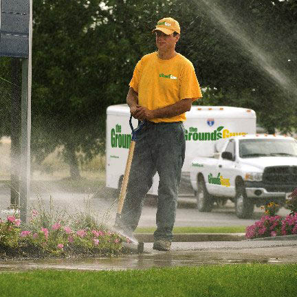 Picture of The Grounds Guys of Overland Park crew member inspecting an irrigation system