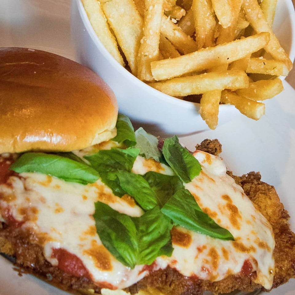 Chicken parm sandwich with fries at Gilroy's in Central Iowa; West Des Moines