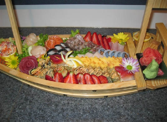Sushi & Sashimi Sampler Platter with fresh seasonal fruits