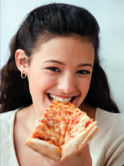Young woman eating pizza.
