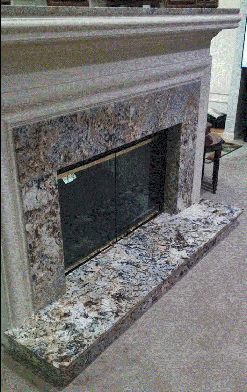 Custom built fireplace surround by GM Cabinets & Flooring in Garden City, MI