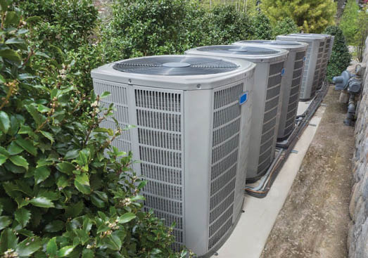 three a/c condensers lined up outside; a/c repair; furnace maintenance; Savannah HVAC