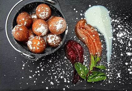 Enjoy Spurgos, Lithuanian cheese curd doughnuts!