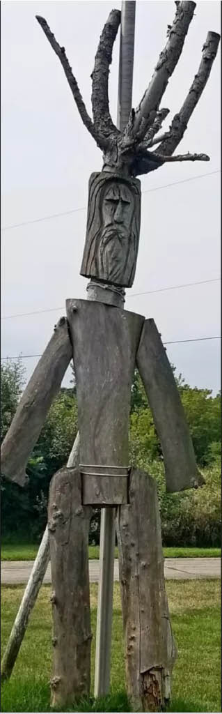 Tree Removal services Waukesha and Milwaukee Greenman wooden statue