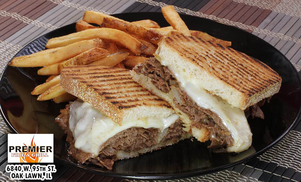 Philly Steak Paninis & fries at Premier Fire & Grill.