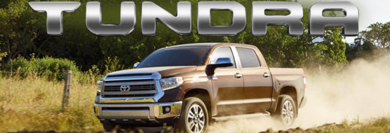 Toyota Tundra truck driving along a country road