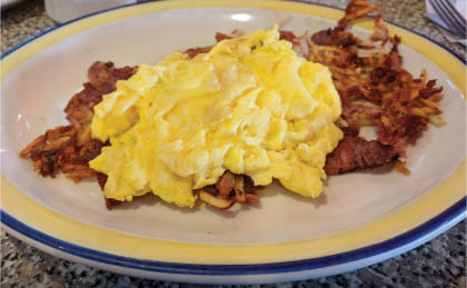 scrambled eggs and hash browns; diners in Sun Prairie