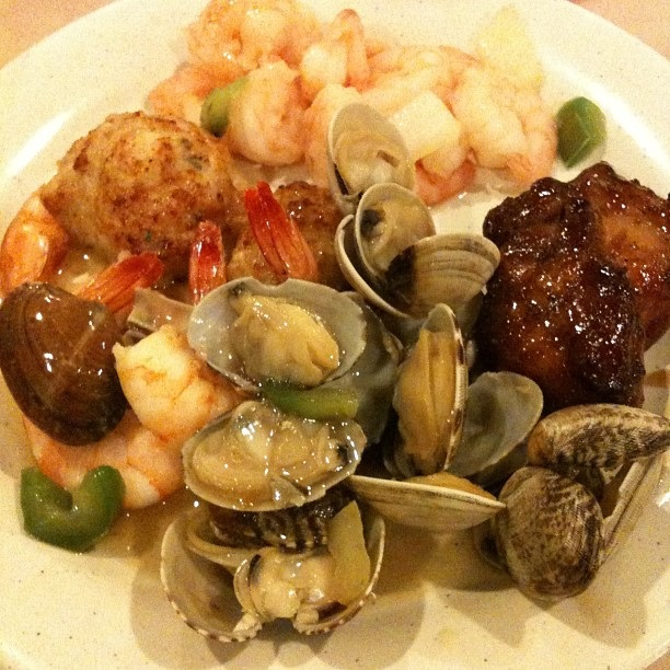 Plate of seafood, meat and cooked food