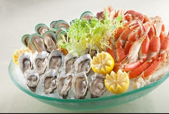 Seafood bowl of crab legs and raw oysters