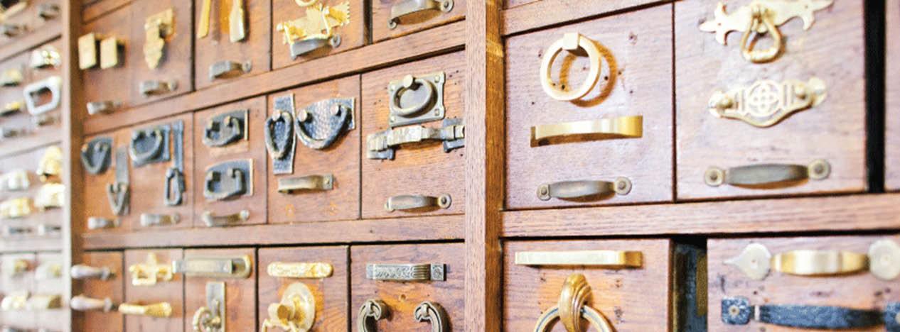 Vintage drawer handles and old wood desks near Pine Hills