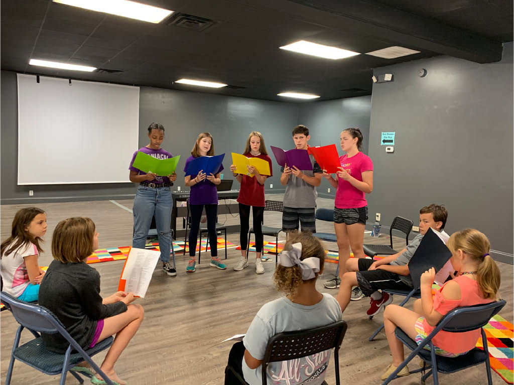 children practicing for upcoming musical at The Hive Repertory Theatre