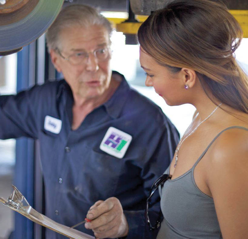 Honest 1 Auto Care technician speaking with a customer in Cottage Grove, MN