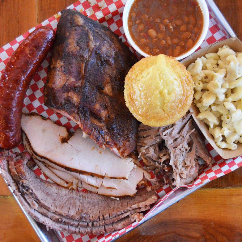 BBQ meat sampler; ribs; brisket; cole slaw; baked beans near St. Louis