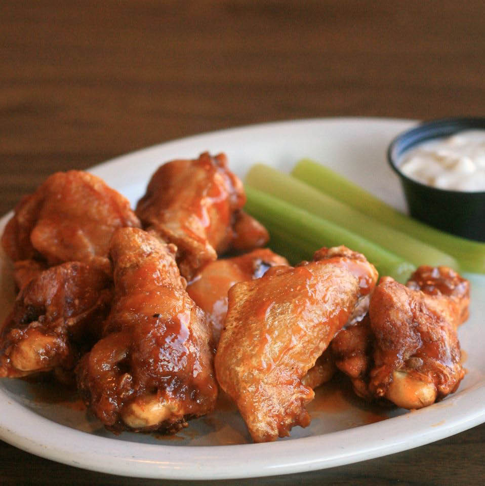 buffalo chicken wings with celery and dressing