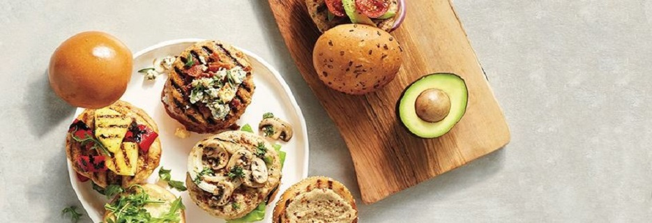 Grilled burgers and sandwiches with fresh vegetables and grilled veggies