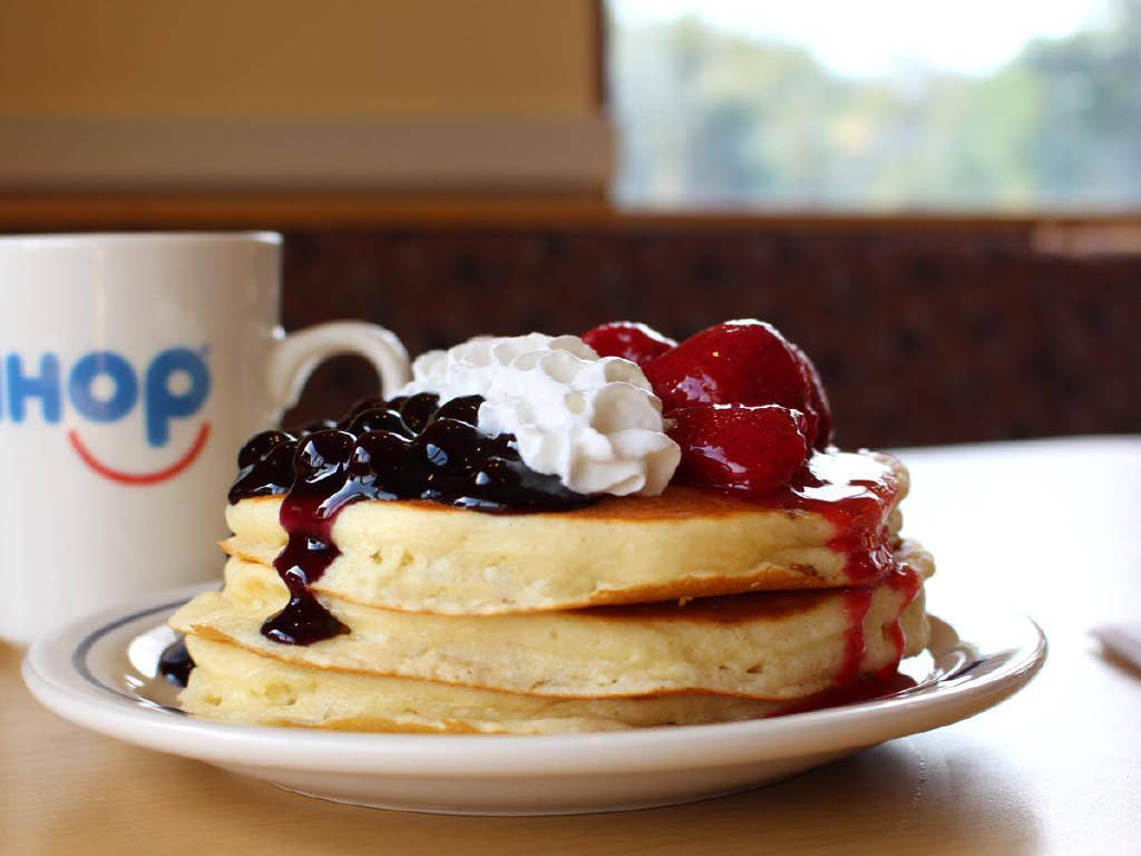 stack of pancakes with fruit and whipped cream from IHOP