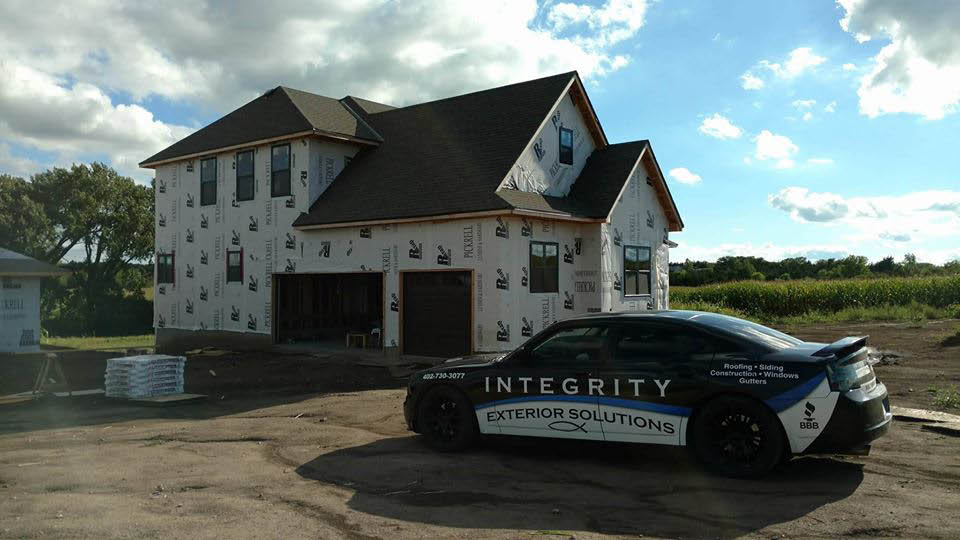 Integrity Exterior Solutions company car & residential project