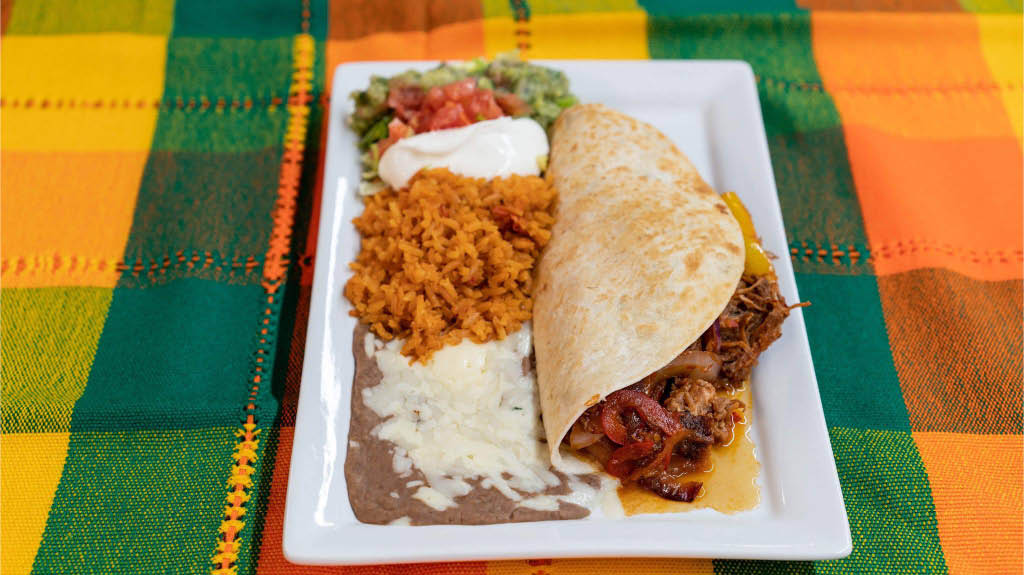 Soft taco, rice and beans at Jalisco Mexican Grill & Cantina