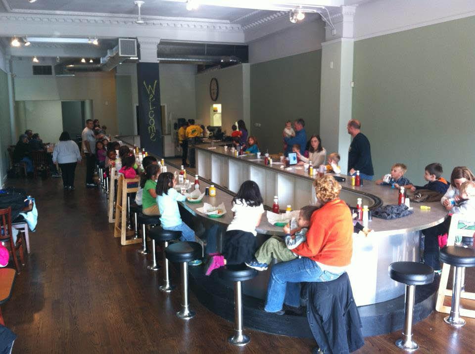 Train diner full of customers near Brewyn