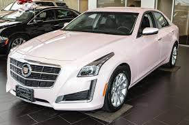 Cadillac & other vehicles in our Cathedral City showroom