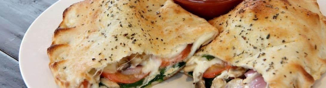 Stromboli with mozzarella, ham, tomatoes and more