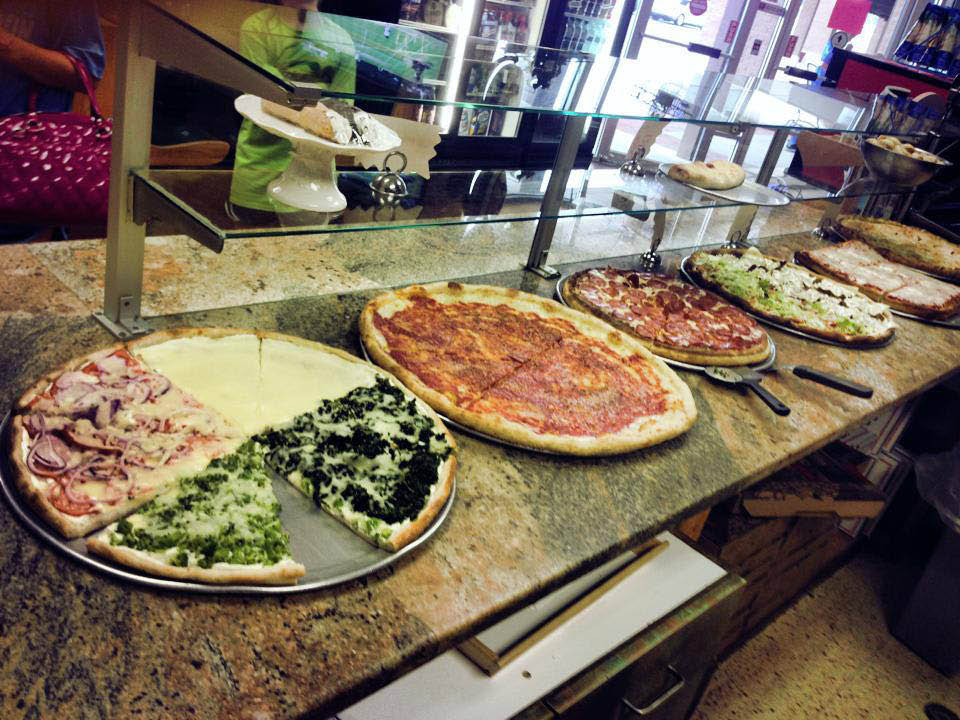 Pizza by the slice, stuffed pizza, Sicilian pizza and thin crust pizza options