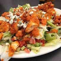 Try Jo Jo's Antipasto or Caesar salad and other salad meal selections