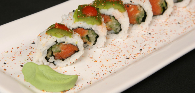 Sushi roll and wasabi leaf