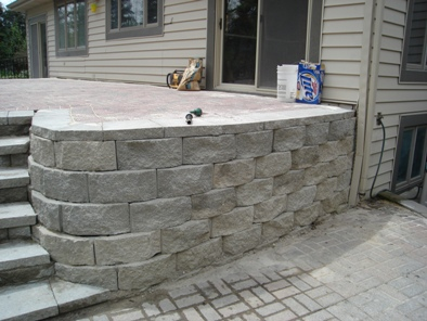 JT Arborists installing a patio block wall in Hartland, WI
