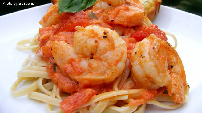 Shrimp served over pasta