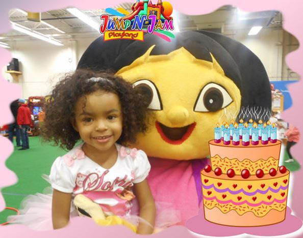 Birthday girl with Dora character at Jump N' Jam Playland.