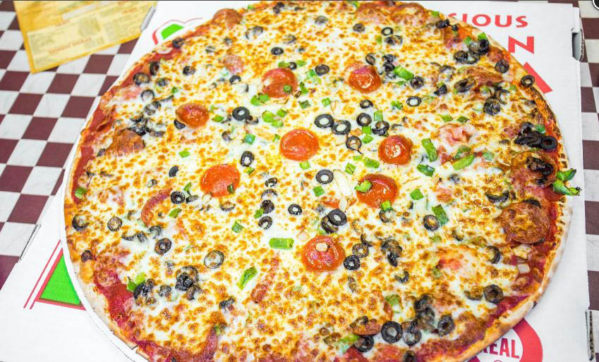 Delicious pizza from Kenootz with locations in Midlothian & Homer Glen, IL.