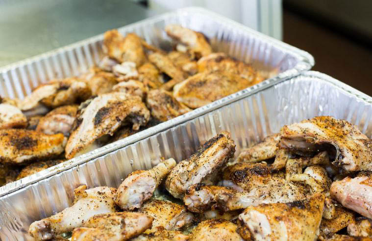 Grecian chicken prepared for catering at Kenootz Pizza.