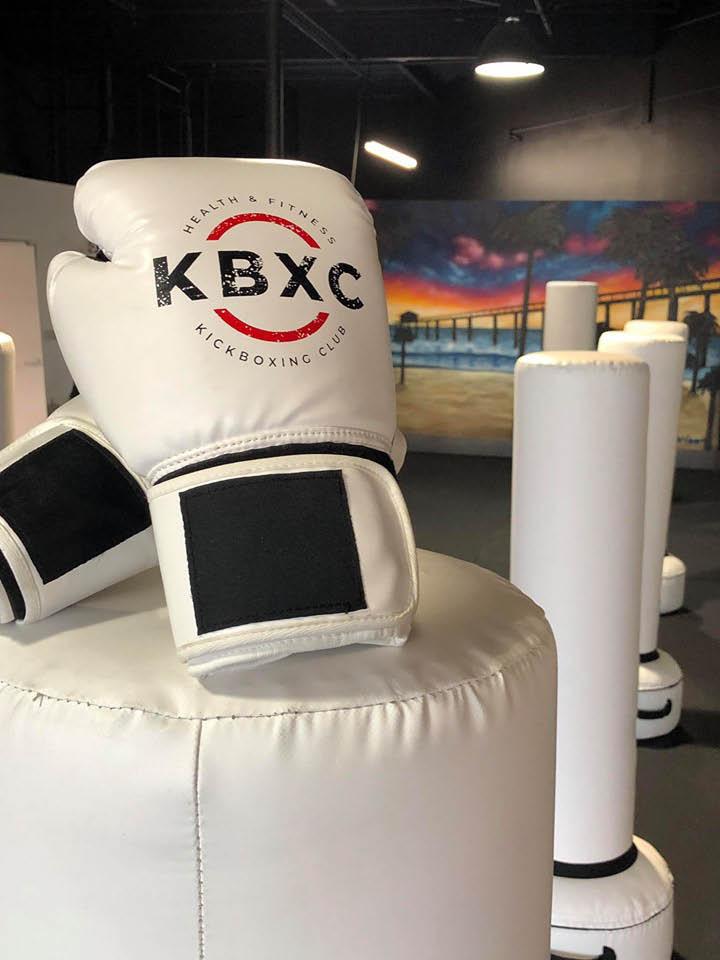 boxing gloves displaying KBXC logo