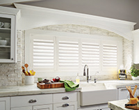 arched kitchen window with custom window treatment from Budget Blinds in Savannah, Georgia