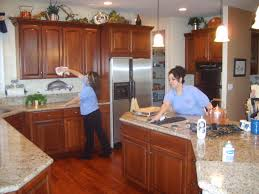 House cleaner cleaning home kitchen; maid services from MaidPro in Chicagoland, Illinois