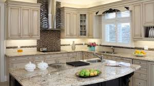 Modern kitchen cabinetry with granite covers near Boys Town