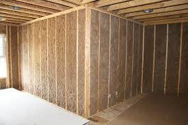 Man spraying-in wall insulation