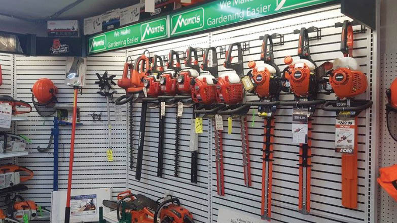 Product line display of commercial-grade hedge trimmers