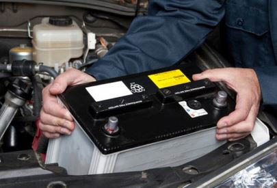 local mechanic performing car battery repair services