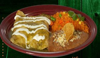 Chicken enchiladas and refried beans with Mexican rice