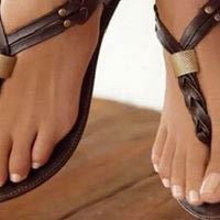 Perfectly pedicured feet look gorgeous in strappy sandals
