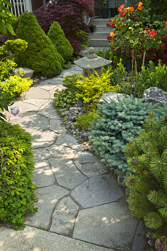 Stone pavers give a natural look to a garden pathway
