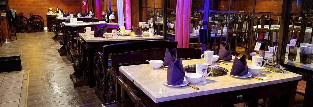 Dining room and table set-up at Lavender Hot Pot