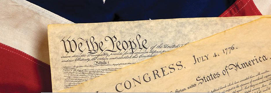 Snippet of the Constitution with red, white and blue behind it