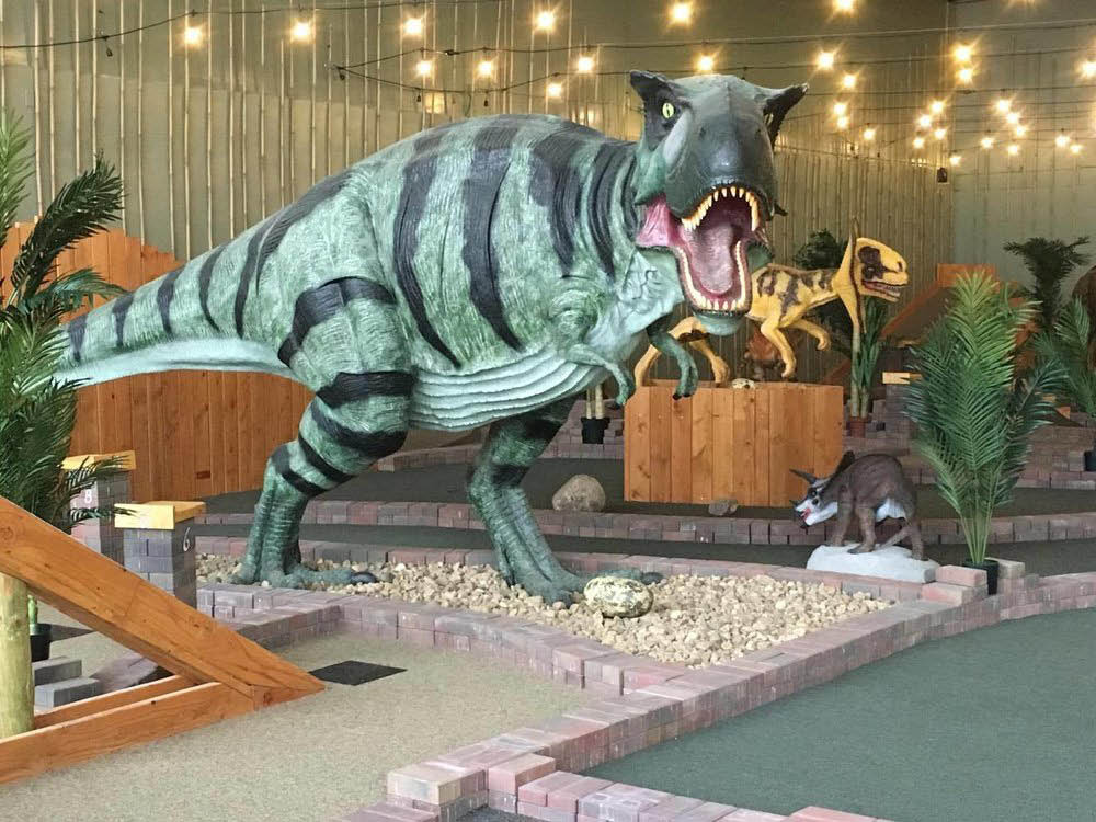 Life size Raptor model dinosaur at Let's Go Putt