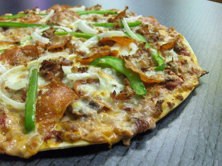 Save on pizza with pizza coupons near Shrewsbury, MO