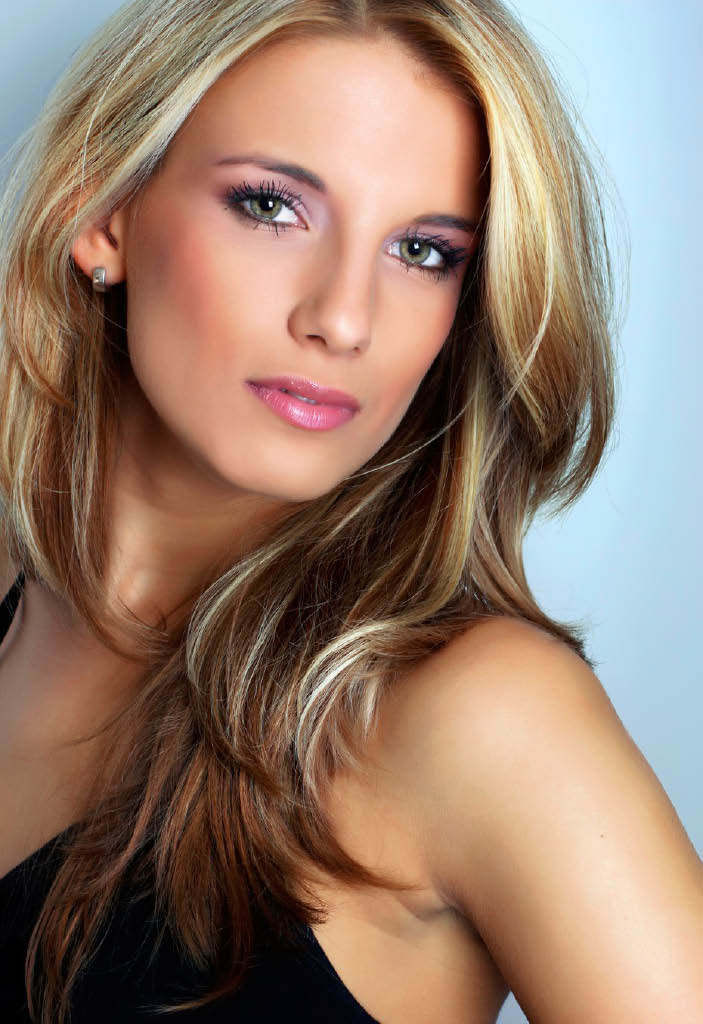 At the Classic Cut Salons of Highlands Ranch and Aurora we offer color, cuts and hair products photo of woman